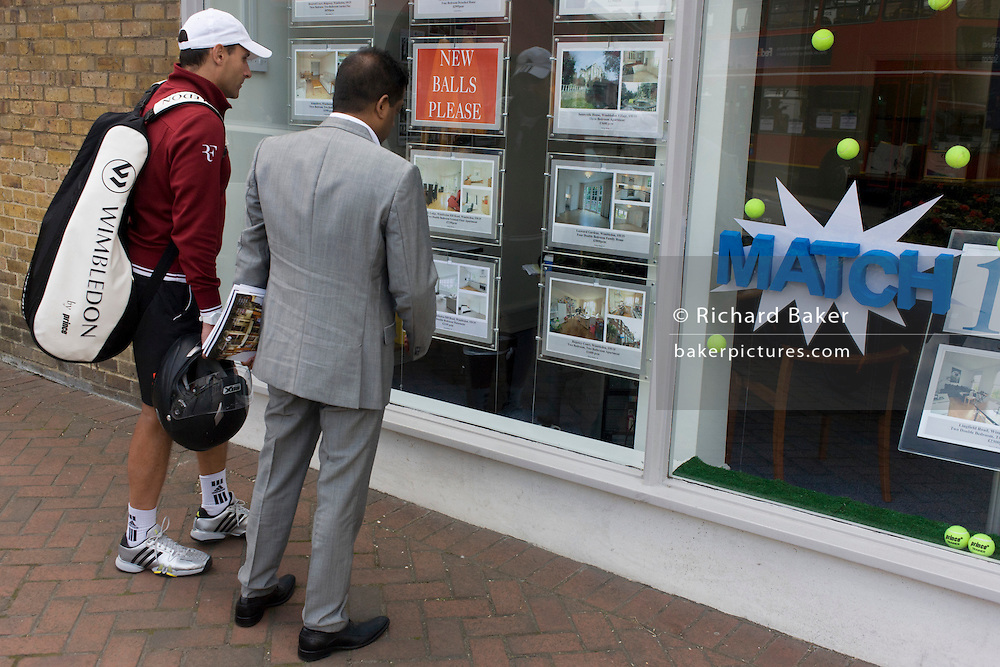 On day 2 of the annual lawn tennis championships, an unknown tennis player looks at property prices in the window of an estate agent in the south London suburb. The Wimbledon Championships, the oldest tennis tournament in the world, have been held at the nearby All England Club since 1877.
