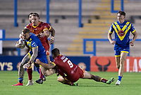 Rugby League - 2020 Super League - Round 13 - Warrington Wolves vs Catalan Dragon<br /> <br /> Warrington Wolves's Josh Charnley is tackled,   at the Halliwell Jones Stadium, Warrington<br /> <br /> <br /> COLORSPORT/TERRY DONNELLY