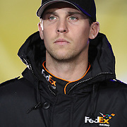 NASCAR Sprint Cup driver Denny Hamlin is seen during the driver introductions prior to the NASCAR Sprint Unlimited Race at Daytona International Speedway on Saturday, February 16, 2013 in Daytona Beach, Florida.  (AP Photo/Alex Menendez)