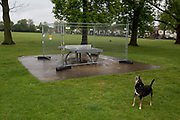 As the UKs Coronavirus pandemic lockdown continues into its 5th week, and UK deaths from Covid-19 reached 21,678 - a daily rise of 586, a dog barks in a deserted Ruskin Park in Lambeth, where until now, this green space in south London has been busy with those exercising according to social distance requirements, on 28th April 2020, in London, England.