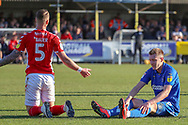 Charlton Athletic defender Patrick Bauer (5) with arms open after a foul on AFC Wimbledon striker Joe Pigott (39) during the EFL Sky Bet League 1 match between AFC Wimbledon and Charlton Athletic at the Cherry Red Records Stadium, Kingston, England on 23 February 2019.