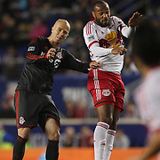 Michael Bradley, (left), Toronto FC, challenges Thierry Henry, New York Red Bulls, during the New York Red Bulls Vs Toronto FC, Major League Soccer regular season match at Red Bull Arena, Harrison, New Jersey. USA. 11th October 2014. Photo Tim Clayton