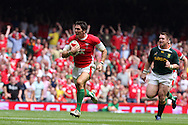 James Hook of Wales breaks away from John Smit as he runs in to score his try. Wales v South Africa,    at Millennium Stadium in Cardiff on Sat 5th June 2010. pic by Andrew Orchard,  Andrew Orchard sports photography,