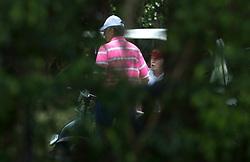 April 8, 2017 - West Palm Beach, Florida, U.S. - President Donald Trump talks with a member of his foursome playing golf at Trump International Golf Club in West Palm Beach, Florida on April 8, 2017. (Credit Image: © Allen Eyestone/The Palm Beach Post via ZUMA Wire)