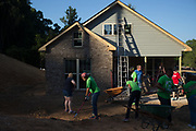 BIRMINGHAM, AL – AUGUST 31, 2015: Volunteers at work on a Habitat for Humanity project.