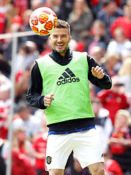 Manchester United Legends David Beckham warms up before the legends match at Old Trafford, Manchester.