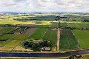 Nederland, Noord-Holland, Beemster, 14-06-2012;  De Beemster, 400 jaar 1612 - 2012. Overzicht met de Boven polder in de voorgrond, in NNO richting langs Middenweg. In de voorgrond het Fort aan de Middenweg en het Noordhollandsch kanaal (tevens Beemsterrringvaart). Middenbeemster aan de horizon. De 17e eeuwse droogmakerij, met haar  beroemde geometrische verkaveling, maakt deel uit van het wereld erfgoed (Unesco werelderfgoedlijst)..The famous geometrical well-ordered polder Beemster, 17th century  reclaimed landscape, Unesco world heritage. Fortress, part of the Defensive Line of Amsterdam also world heritage..luchtfoto (toeslag), aerial photo (additional fee required);.copyright foto/photo Siebe Swart