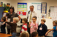 "Participating in the ""Read for the Record"" early childhood literacy campaign LRCC President Dr. Scott Kalicki reads ""Frankie Stein"" as Mrs. Chase uses sign language for the first grade students in Mrs. Faria's and Mrs. Olson's classrooms at Pleasant Street School Thursday afternoon.  (Karen Bobotas/for the Laconia Daily Sun)"
