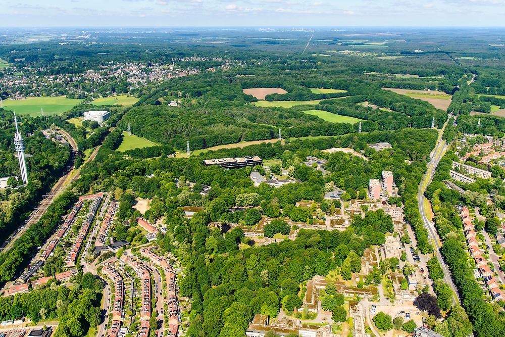 Nederland, Gelderland, Arnhem, 29-05-2019; Overzich Arnhem West Mariëndal. In de voorgrond Het Dorp, oorspronkelijk gebouwd voor mensen met ernstige lichamelijke of meervoudige handicap. De bungalow woningen (met mos op het dak) worden deels gesloopt / gerenoveerd.<br /> The Village, originally built for people with severe physical or multiple disabilities. <br /> <br /> luchtfoto (toeslag op standard tarieven);<br /> aerial photo (additional fee required);<br /> copyright foto/photo Siebe Swart