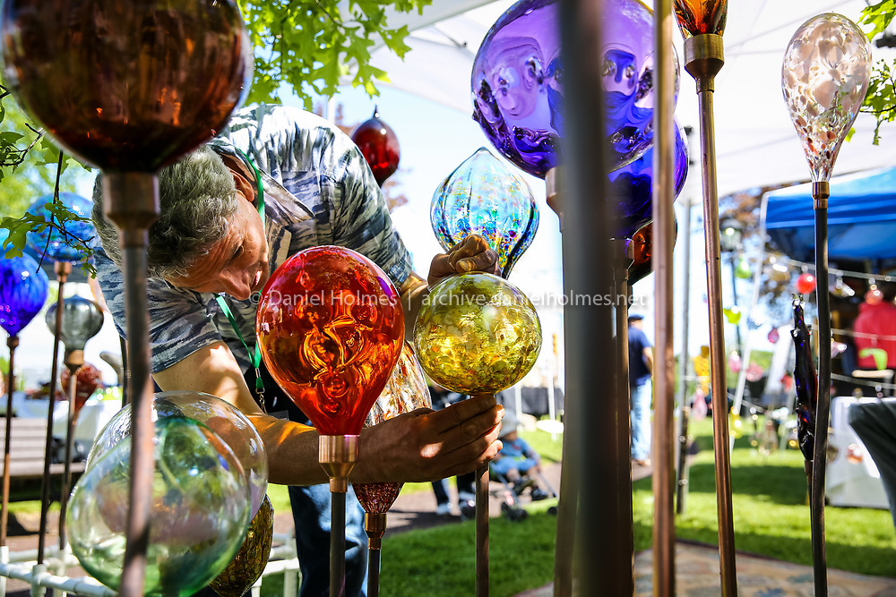 """(5/31/14, WRENTHAM, MA) Glass artist Neal Drobnis of North Scituate, RI, puts some of his work on display during the second annual """"Arts on the Common"""" event on the town common in Wrentham on Saturday. Daily News and Wicked Local Photo/Dan Holmes"""