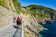 Tourists on the Via dell'Amore (The Way of Love), Riomaggiore, Cinque Terre, Liguria, Italy