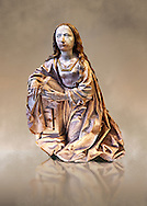Painted alabaster statue of the Virgin of the annunciation, made around 1495 by Tilman Riemenschneider of Heiligenstadt im Eichsfeld, Germany The statue would have originally bee accompanied by another of the  Gabriel and both would have formed part of an altarpiece. Inv RF 1384,  The Louvre Museum, Paris. .<br /> <br /> If you prefer you can also buy from our ALAMY PHOTO LIBRARY  Collection visit : https://www.alamy.com/portfolio/paul-williams-funkystock/gothic-art-antiquities.html  Type -   louvre     - into the LOWER SEARCH WITHIN GALLERY box. Refine search by adding background colour, place, museum etc<br /> <br /> Visit our MEDIEVAL ART PHOTO COLLECTIONS for more   photos  to download or buy as prints https://funkystock.photoshelter.com/gallery-collection/Medieval-Gothic-Art-Antiquities-Historic-Sites-Pictures-Images-of/C0000gZ8POl_DCqE