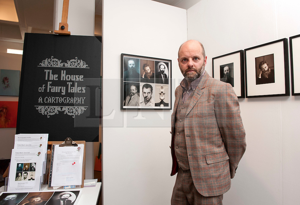 © Licensed to London News Pictures. 05/06/2015. Bristol, UK.  The Other Art Fair comes to the Arnolfini Gallery in Bristol.  Picture of Gavin Turk with his Project Beard work. Gavin is one of the group known as Young British Artists from the 1990's and was on the selection committee for The Other Art Fair and all the proceeds from sales of Project Beard at the Fair will go to fundraising for the charity House of Fairy Tales which provides art experiences for children across the UK.  As the UK's leading artist fair, The Other Art Fair gives art lovers the unique opportunity to buy directly from 70 of the best emerging and undiscovered artists.  Photo credit : Simon Chapman/LNP