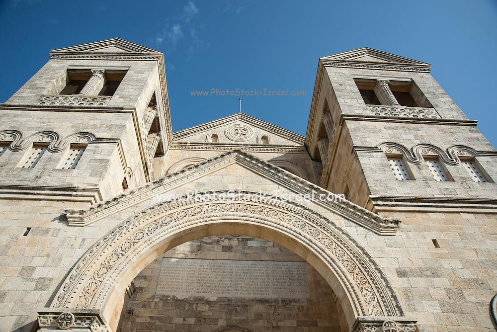 Exterior of the Franciscan church of the Transfiguration, mount Tabor, Jezreel Valley, Galilee, Israel (architect Antonio Barluzzi 1924). Latin inscription over the door