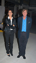 PRINCESS CAROLINE OF MONACO and hr husband PRINCE ERNST OF HANOVER at an exhibition of work by Rolf Sachs - a unique world-renowned contemporary furniture designer, held in association with the Louisa Guinness Gallery and held at 250 Brompron Road, London on 6th October 2004.<br />