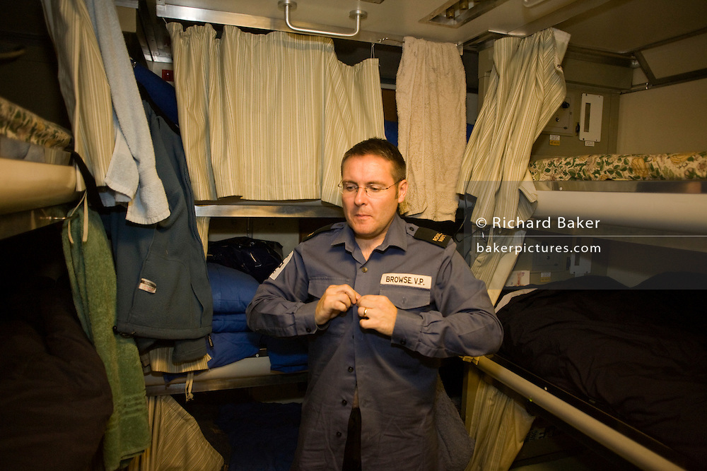 Able-bodied sailor gets dressed in his Junior Rating quarters aboard HMS Vigilant, a Vanguard class nuclear submarine