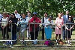 © London News Pictures. 07/07/15. London, UK. Members of the public hold a minute's silence at the 7/7 memorial in Hyde Park to mark the 10 year anniversary of the 7/7 London bombings, Central London. Photo credit: Laura Lean/LNP