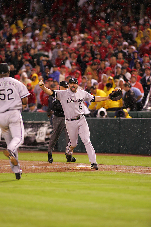 ANAHEIM - OCTOBER 16:  Paul Konerko #14 of the Chicago White Sox touches first base to record the final out in the ninth inning during Game 5 of the American League Championship Series against the Los Angeles Angels of Anaheim at Angels Stadium on October 16, 2005 in Anaheim, California.  The White Sox defeated the Angels 6-3 to advance to the World Series.