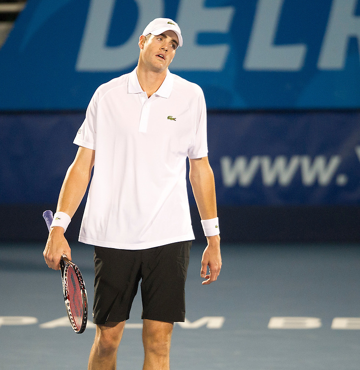John Isner (USA) in action during his defeat by Edouard Roger-Vasselin (FRA) in their Semi Final match today - Edouard Roger-Vasselin (FRA) def John Isner (USA) 6-4 4-6 6-4..ATP 250 Tennis - 2012 Delray Beach International Tennis Championships - Day 6 -  Saturday 2nd March 2013 - Delray Beach Stadium & Tennis Center - Delray Beach - Florida - USA..© CameraSport - 43 Linden Ave. Countesthorpe. Leicester. England. LE8 5PG - Tel: +44 (0) 116 277 4147 - admin@camerasport.com - www.camerasport.com