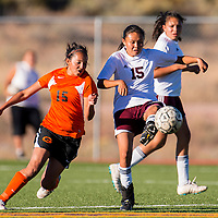 092613       Brian Leddy<br /> Rehoboth Lynx Shannon Begay (15) kicks the ball as Gallup Bengal (15) Danitza Zavala gives chase during Thursday's game at Rehoboth.