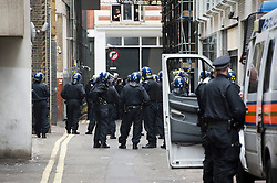 © London News Pictures. 11/06/2013. London, UK. Police waiting to raid a squat at abandoned police station on Beak Street, London which is being used by Anti-G8 activists as their headquarters ahead of a demonstration in central London today (Tues) The G8 Summit is due to take place in Norther Ireland early next week.  Photo credit: Ben Cawthra/LNP
