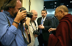 17 May 2013. New Orleans, Louisiana,  USA..AP superstar photographer Gerald Herbert  photographs His Holiness the 14th Dalai Lama at the press conference preceeding the 'Resiliance - Strength through Compassion and Connection' conference. .Photo; Charlie Varley.