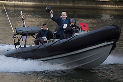 © licensed to London News Pictures. London, UK 30/10/2012. Boris Johnson arriving to HMS Severn on a poppy branded RIB to launch London Poppy Day with the captain and crew of HMS Severn in Canary Wharf. Photo credit: Tolga Akmen/LNP