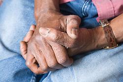 Elderly man's clasped hands,