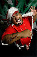 Hip hop star Savage dressed as Savage Santa. December 2004.<br /> Photograph Richard Robinson.<br /> 2004 © New Zealand Herald A Division of APN New Zealand Ltd.<br /> No Reproduction without prior written permission. Contact www.newspix.co.nz to licence photograph.