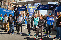 Elite runners meet and greet spectators at the finish line. Meb Keflezighi,