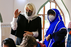 © Licensed to London News Pictures. 07/04/2021. London, UK. Camilla, Duchess of Cornwall, wearing a protective face covering and headscarf waves to the children during a visit to the London Islamic Cultural Society and Mosque (also known as Wightman Road Mosque) in Haringey, north London. The Mosque was formed by a small group of Guyanese Muslims and now supports over 30 different nationalities and community in Haringey and surrounding boroughs. Photo credit: Dinendra Haria/LNP