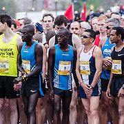 Some of the elite men runners on the start line just moments before the start of the 2012 Cherry Blossom 10-Miler. In the center of frame, in the number 9 bib, is the eventual winner, Allan Kiprono from Kenya, who set a new course record of 45:15. To his right, in number 11, is Lani Kiplagat, also from Kenya, who came second in 46:28. This year was the 40th running of the race that is run every spring in Washington DC to coincide with the National Cherry Blossom Festival. The course starts near the Washington Monument, heads over Memorial Bridge and back, goes up under the Kennedy Center, around the Tidal Basin and past the Jefferson Memorial, and then does a loop around Hains Point back to the finish near the Washington Monument.