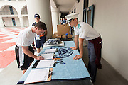 An incoming Citadel freshman known as a knob signs for newly issued gear during matriculation day on August 17, 2013 in Charleston, South Carolina. The Citadel is a state military college that began in 1843.