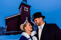 Bride and groom kissing outside the church after their wedding ceremony at Plassen Church (kirke), a wooden (stave) church originally built in 1879. It burnt to the ground in 1904 and was rebuilt in 1907. Trysil, Norway.