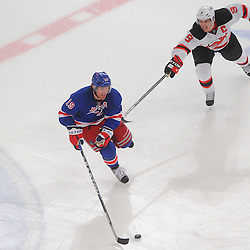 May 14, 2012: New York Rangers center Brad Richards (19) skates the puck away from New Jersey Devils left wing Zach Parise (9) during third period action in game 1 of the NHL Eastern Conference Finals between the New Jersey Devils and New York Rangers at Madison Square Garden in New York, N.Y. The Rangers defeated the Devils 3-0.