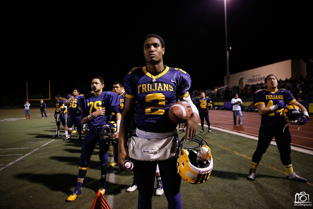 Tre Hartley (2) stands with his teammates during the playing of the National Anthem during the CCS Division 1 playoff game against No. 7 Homestead at Milpitas High School in Milpitas, California, on November 22, 2013. No. 2 Milpitas beat Homestead 62-28. (Stan Olszewski/SOSKIphoto)