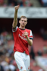 Arsenal's Per Mertesacker celebrates Arsenal winning - Photo mandatory by-line: Mitchell Gunn/JMP - Tel: Mobile: 07966 386802 22/09/2013 - SPORT - FOOTBALL - Emirates Stadium - London - Arsenal V Stoke City - Barclays Premier League