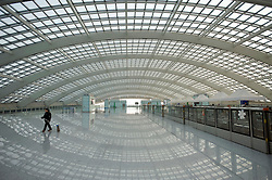 Interior of large modern new Airport Express railway station at Beijing Airport Terminal 3 China 2009