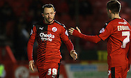 Crawley Town striker Rhys Murphy is congratulated by Crawley Town midfielder Gwion Edwards on his match-winning performance during the Sky Bet League 2 match between Crawley Town and Bristol Rovers at the Checkatrade.com Stadium, Crawley, England on 21 November 2015. Photo by Bennett Dean.