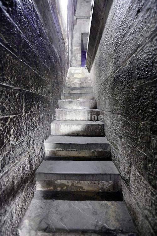 narrow stairs corridor inside medieval tower