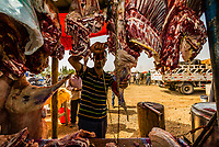 A butcher at work at the Sunday Livestock market just outside Kashgar (China's westernmost city), Xinjiang Province, China. Kashgar is along the Silk Road, near Tajikistan and Pakistan.