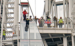 © London News Pictures. 03/09/2012. London, UK.  Prince Andrew starting his descent. Prince Andrew, The Duke of York abseiling down The Shard building in Central London on September 3, 2012. The Prince joined Ffion Hague billionaire John Caudwell and a team of 37 others to take part in a charity abseil down London's tallest building to raises funds for The Outward Bound Trust and the Royal Marines Charitable Trust Fund. Photo credit: Ben Cawthra/LNP
