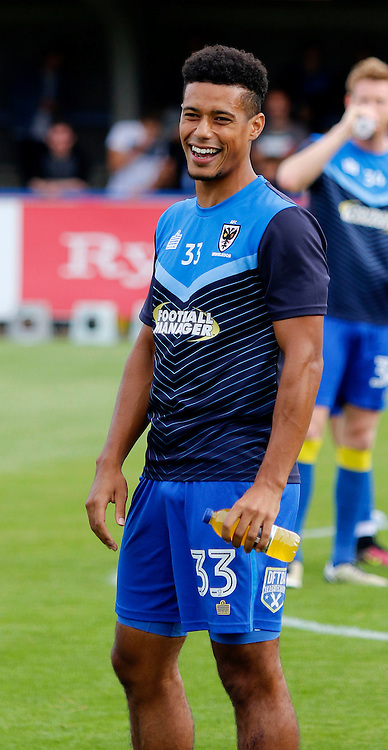 AFC Wimbledon's Lyle Taylor warms up prior to the Sky Bet League 1 match between AFC Wimbledon and Shrewsbury Town at the Cherry Red Records Stadium in Kingston. September 24, 2016.<br /> Carlton Myrie / Telephoto Images<br /> +44 7967 642437
