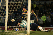 Cardiff city goal keeper Dimi Konstantopoulos dives to save from Liam Miller. Coca Cola championship, Cardiff City v QPR match at Ninian Park in Cardiff on Wed 25th Feb 2009. pic by Andrew Orchard, Andrew Orchard sports photography.