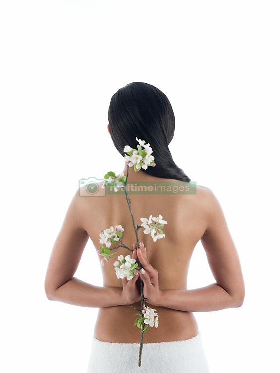 Jul. 26, 2012 - Woman holding branch behind back (Credit Image: © Image Source/ZUMAPRESS.com)