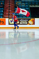KAMLOOPS, CANADA - NOVEMBER 5: The flag bearer skates with the Canadian Flag during opening ceremonies of the CHL Canada Russia series on November 5, 2018 at Sandman Centre in Kamloops, British Columbia, Canada.  (Photo by Marissa Baecker/Shoot the Breeze)