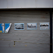 In Matsushima, posters with images of destruction can be seen on display in the doors of a shop closed down due to the damaged cause by the 2011's tsunami that struck Japan's coastal line, causing thousands of deaths.