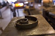 A metal working form to shape hot iron in an metal shop in Charleston, SC