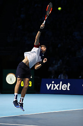 Nicolas Mahut serves during his doubles match with team mate Pierre-Hugues Herbert against Horia Tecau and Jean-Julien Rojur during day one of the NITTO ATP World Tour Finals at the O2 Arena, London.
