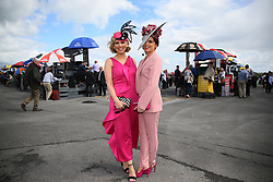 Michelle Barrett Manning (left) and her sister Sharon Barrett, from Belmullet, attending Friday's Fair Lady Day of the Galway Summer Festival at Galway Racecourse.